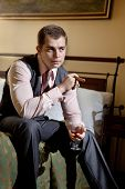 stock photo of cigar  - Smart gentleman is going to smoke cigar and drink whiskey - JPG