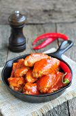picture of saucepan  - Hot Chicken Wings Barbecue in Black Saucepan isolated - JPG
