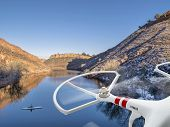 picture of horsetooth reservoir  - quadcopter drone flying over lake with a canoe  - JPG