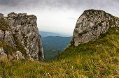 stock photo of serbia  - Rocks and cliffs under dark clouds trekking path near Trem peak at Suva Planina mountain in East Serbia - JPG