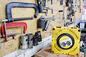 image of benchmarking  - Car repair workshop tools on the wall - JPG