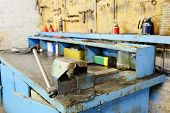 pic of workbench  - The image of a old vice on a metal workbench - JPG