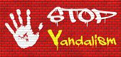 picture of graffiti  - stop vandalism deliberate destruction of or damage to public or private property graffiti on red brick wall - JPG