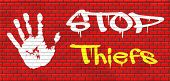 pic of theft  - catch thiefs stop theft no robbery or pick pocket thief arrest by police investigation or neighborhood watch online internet thief graffiti on red brick wall - JPG