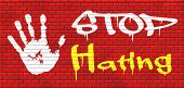 foto of stop hate  - no hate stop hating start love tolerance and forgiveness forgive enemies no discrimination or racism graffiti on red brick wall - JPG