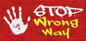 pic of graffiti  - wrong way stop and take a uturn making a mistake turn back now bad direction graffiti on red brick wall - JPG