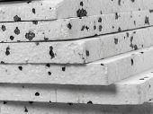 foto of insulator  - Closeup of insulation styrofoam panels with graphite additive - JPG