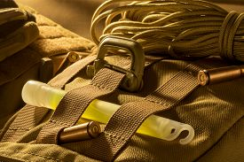 image of paracord  - Molle plate with polimer carabineer glow stick paracord and ammunition rounds - JPG