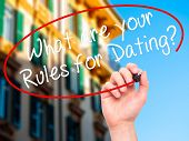 stock photo of taboo  - Man Hand writing What are your Rules for Dating - JPG