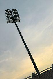 image of light-pole  - pole sport light  and a sunset sky background - JPG