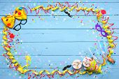 Colorful carnival background with party accessory, streamers, confetti, ribbon, doughnuts and champa poster