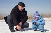 picture of ice fishing  - The boy the child with the father on on winter fishing - JPG