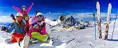Skiing, winter, snow, sun and fun - family enjoying winter vacations poster