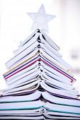 books shaped Christmas tree at home for Christmas holiday decoration, background close up  poster