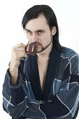 stock photo of housecoat  - sleepy man in housecoat with little cup of coffee - JPG