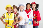 stock photo of fireman  - group of kids in uniforms costumes - JPG