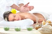 image of massage therapy  - Beautiful young woman getting spa massage - JPG
