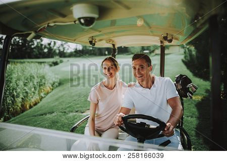 Happy Young Couple In White