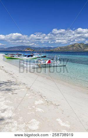 Boats Docked On A Beach