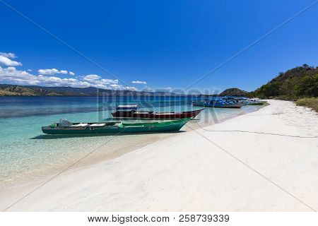 Boats On A White Sand