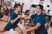 Young Father And Son Preparing For Training In Gym. Healthy Lifestyle Concept. Sport And Training Co poster