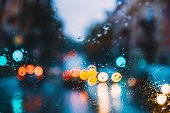 Rain Water Drops On Blue Glass Background In Night Or Evening Street Lights. Street  Bokeh Boke Ligh poster