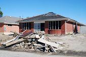 stock photo of katrina  - Damaged house in the midst of renovation in the aftermath of Hurricane Katrina - JPG