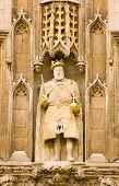 stock photo of sceptre  - A Tudor statue of King Henry VIII on the Great Gate to Trinity College - JPG
