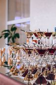 Delicious Wedding Reception Candy Bar Dessert Table. A Lot Of Alcohol And Glasses. Coktails And Swee poster