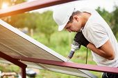 Profile Of Professional Technician Working With Screwdriver Connecting Solar Photo Voltaic Panel To  poster