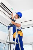 stock photo of air conditioning  - Worker finished mounting air conditioning indoor unit - JPG
