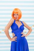 She Likes Bright Outfit. Girl Posing Striped Background Of Studio. Lady Red Ginger Wig Posing In Blu poster