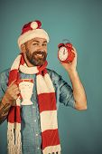 Christmas Hipster In Santa Hat, Scarf Smile On Blue Background. Countdown To Midnight. Time To Celeb poster