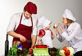 Happy Family Preparing Lunch In Kitchen. Healthy Lifestyle. Mom, Dad&kid Cooking Food Together. Happ poster
