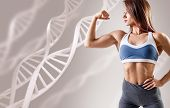 Athletic Fitness Woman Standing Among Dna Chains. Metabolism Concept. poster