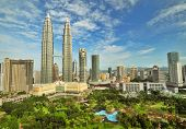 stock photo of petronas towers  - Petronas Twin Towers in Malaysia in Summer Sunny Day - JPG