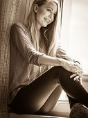 Smiling Young Woman Teenage Girl Sitting On Window Sill, Energizing Morning, Relaxing Having Good Ti poster