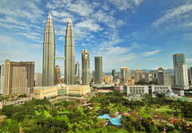stock photo of klcc  - Petronas Twin Towers in Malaysia in Summer Sunny Day - JPG