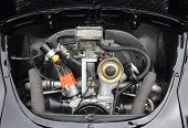 stock photo of beetle car  - A beetle engine in a black bay looking very clean - JPG