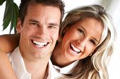 picture of love couple  - Young love couple smiling in the comfortable apartment - JPG