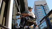 picture of window washing  - Workers washing the windows facade of a modern office building  - JPG