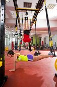 foto of dipping  - Crossfit fitness TRX training exercises at gym woman push - JPG