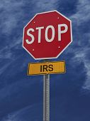pic of irs  - stop irs conceptual road sign over sky - JPG