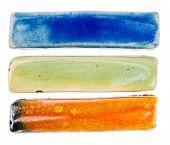 stock photo of raku  - Handmade glazed ceramic elements isolated on white - JPG