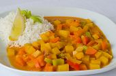 stock photo of rutabaga  - Dish of curry vegetables including rice and lemon as a complement - JPG