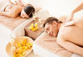 stock photo of all-inclusive  - picture of couple in spa salon getting massage - JPG