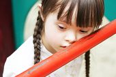 foto of shy girl  - Portrait of beautiful young girl on the playground - JPG