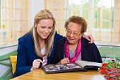 stock photo of visitation  - a grandchild visiting his grandmother - JPG