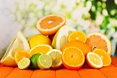 stock photo of pamelo  - Lots ripe citrus on wooden table on natural background - JPG