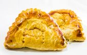 pic of crescent-shaped  - Thai Curry Puff?A curry puff is a deep-fried, crescent-shaped pastry filled with curried potato and meat